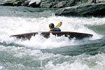 Chris Bell in his kayak surfing Jaws, Nolichucky (NC-TN).  Copyright Lani Anderson.