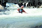 Kristi Schleder in her kayak paddling Crooked Fork Creek (TN).  Copyright Chris Bell.