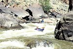 Philip Curry and Edward Chapman in their kayaks paddling Cross Mountain Gorge of the Yampa (CO).  Copyright Chris Bell.
