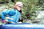 Robin Knupp in her kayak at the put-in, Upper Gauley (WV).  Copyright Chris Bell.
