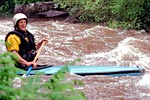 Charlie Walbridge in his decked canoe paddling the Cheoah (NC).  Copyright Chris Bell.