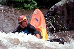 Alan Wray in his kayak throwing ends on the Cheoah (NC).  Copyright Chris Bell.