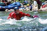 Leland Davis in his squirt boat doing a mystery move at Cowbell, Nolichucky (TN).  Copyright Chris Bell.