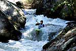 Unknown boater in his kayak paddling Bride of Frankenstein, Green Narrows (NC).  Copyright Chris Bell.