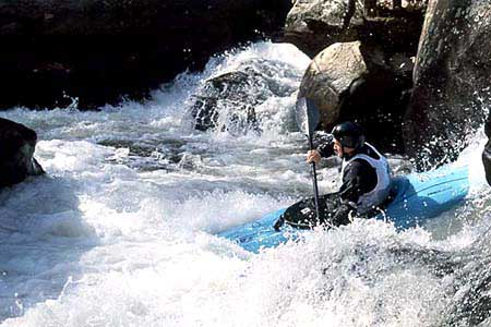 Unknown boater in his kayak racing through Frankenstein, Green Narrows (NC).  Copyright Chris Bell.