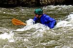 Chris Bell in his squirt boat doing a mystery move at Cowbell, Nolichucky (TN).  Copyright Matt Buys.