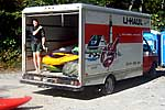 Matt Buys standing in the back of a U-Haul truck full of kayaks, Upper Gauley (WV).  Copyright Chris Bell.