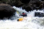 Unknown boater in his kayak racing through Pin Cushion, Green Narrows (NC).  Copyright Chris Bell.