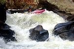 Mark Vanderwerf in his kayak racing through Go Left and Die, Green Narrows (NC).  Copyright Chris Bell.