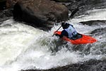 Glen LePlante in his kayak racing through Zwick's Backender, Green Narrows (NC).  Copyright Chris Bell.
