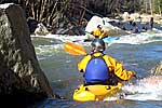 Mike Lewis and Unknown in his kayak paddling S-Kicker, Watauga Gorge (NC).  Copyright Chris Bell.